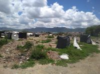 [HAY FOTOS] Tras el acuerdo con el Gobierno, desarman las casillas de Parque La Vega y se retiran las familias